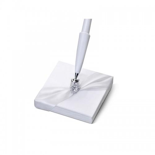 Stojaczek z białym długopisem z perłowego papieru